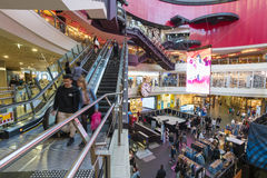 Busy shopping mall. Melbourne, Australia - May 15, 2016: People visiting Melbourne Central, which is a complex with shopping mall, office tower and railway Stock Photos