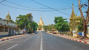 Busy Shwedagon Pagoda Road, Yangon, Myanmar. YANGON, MYANMAR - FEBRUARY 17, 2018: The walk along the Buddhist Temples - Tant Taw Mu Pagoda and Mahavijaya Pagoda stock video footage