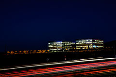 Busy Silicon Valley Night Freeway and Office Cityscape Royalty Free Stock Photos