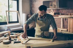 Busy skilled masterful experienced confident bearded dressed in royalty free stock photography