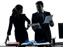 Busy smiling business woman man couple silhouette Stock Photos
