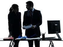 Busy smiling business woman man couple silhouette Royalty Free Stock Images
