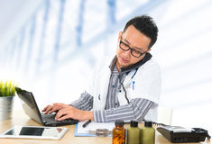 Busy Southeast Asian medical doctor Royalty Free Stock Photo