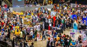 Busy stalls at Yorkshire Cosplay Convention. Sheffield, UK - June 11, 2016:  Crowds enjoying the stalls selling character goods and costumes  at the Yorkshire Royalty Free Stock Photo
