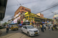 Busy steet of Kolkata, traffic and ancient building royalty free stock photo