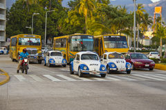 Busy street in acapulco. Busy street with taxis and buses in acapulco Stock Image
