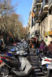 Busy street in Barcelona with bike parking Royalty Free Stock Image