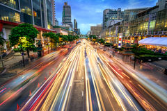 Busy street at dusk, full of car light streaks Royalty Free Stock Images