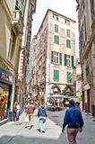 The busy street. Genoa, Italy - May 9, 2012 - The high narrow house on Via San Luca, the popular tourist and shopping street in Genoa Royalty Free Stock Photos