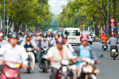 Busy street in Ho Chi Minh City. Vietnam. Street view in Ho Chi Minh City (Saigon) in Vietnam. Southeast Asia. Busy daily traffic with lots of motorbikes and Royalty Free Stock Images