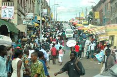A busy street in Kumasi, Ghana. Kumasi, Ghana: 21st July 2016 - a bustling street scene with people and cars in Kumasi, West Africa stock photography