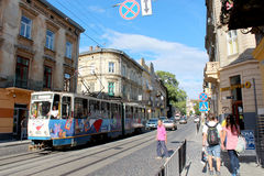 Busy street in Lviv with people and tram Stock Image