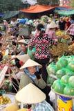 Busy street market, Hanoi, Vietnam. Busy street market in Hanoi, Vietnam, with women and fruit Royalty Free Stock Image