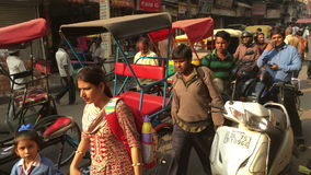 Busy street in Old Delhi - India. Delhi, India - November 24, 2015: Crowded and noisy street in Old Delhi crammed with people busy with their daily activities stock video