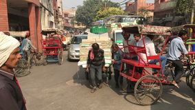 Busy street in Old Delhi - India. Delhi, India - November 20, 2015: Crowded and noisy street in Old Delhi crammed with vehicles and people busy with their daily stock video