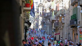 Busy street in old town of Barcelona, Spain