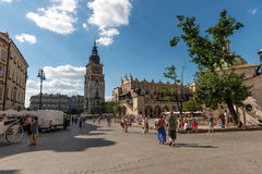 Busy street of polish krakow, ancient architecture Stock Image