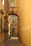 The narrow streets of Mdina Malta. A `busy` street in the unique city of Mdina, Malta. Steep street leading to the fishing harbour Royalty Free Stock Photos