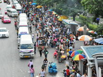 Busy Street. View of a busy street outside Chatuchak Market on November 18, 2012 in Bangkok, Thailand. The Thai capital has grown rapidly with a population of 8 Royalty Free Stock Photos
