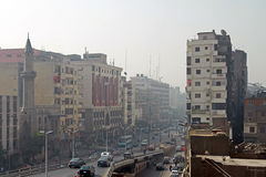 Busy streets of Cairo. CAIRO, EGYPT - MARCH 11: Busy streets of Cairo with traffic and high contrast between poverty and wealth Stock Images
