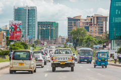 Busy streets of Downtown Dar Es Salaam. Dar Es Salaam: April 22: Traffic slows down travellers on the busy streets of Downtown Dar Es Salaam on April 22, 2015 in Royalty Free Stock Photos