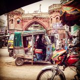 Busy streets of multan pakistan. A classical rickshaw stuck in the busy streets of Royalty Free Stock Image
