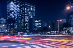 Busy streets of Osaka at night time with light trails Royalty Free Stock Photos
