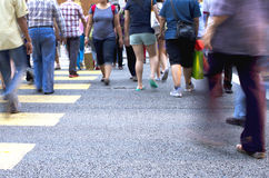 Busy streets. Pedestrians crossing a busy street stock photography