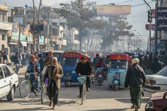 Busy streets of Quetta. Cars, bicycles and rickshaws on a busy road in Quetta, Pakistan Royalty Free Stock Images