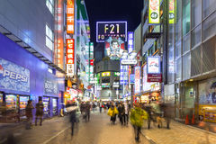 Busy streets of Shibuya district in Tokyo at night, Japan Stock Photo