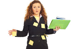 Busy stressed business woman. With reminder notes on her suit holding folders isolated on white background Royalty Free Stock Photos