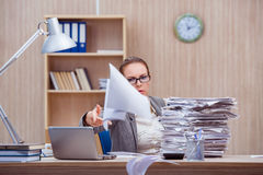 The busy stressful woman secretary under stress in the office Stock Photo