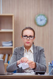 The busy stressful woman secretary under stress in the office Royalty Free Stock Image