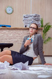 The busy stressful woman secretary under stress in the office Stock Image