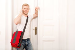 Busy student coming home Stock Photography
