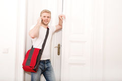 Busy student coming home Stock Photos