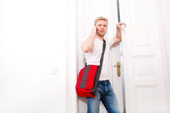 Busy student coming home Royalty Free Stock Photography