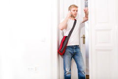 Busy student coming home Royalty Free Stock Photos