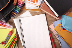 Busy student school desk with blank folded writing book, copy space Stock Photography