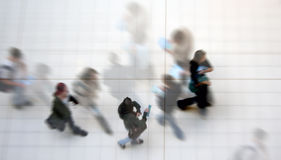 Busy students. Abstract image of students walking inside college Royalty Free Stock Photography