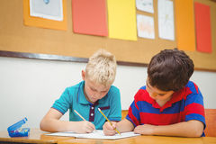 Busy students working on class work. At the elementary school Royalty Free Stock Photo