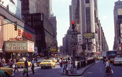 Times Square, circa 1970`s. Busy summer day in Times Square, Manhattan. Image taken by color slide royalty free stock photos