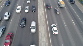 A busy summer ten lane road. Car traffic at highway. A top angle view of a road with a raised concrete median barrier stock footage