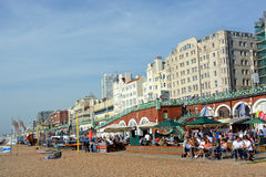 A Busy Sunday Lunchtime on Brighton Beach. Royalty Free Stock Images