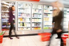 Busy Supermarket With Motion Blur Royalty Free Stock Photos
