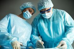 Busy surgeons Royalty Free Stock Image