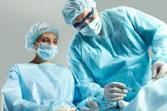 Busy surgeons Stock Photo