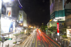 Busy Taipei street in the night with motion blured car lights Royalty Free Stock Image