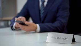 Busy tax manager using mobile app on smartphone, consulting clients online. Stock photo stock photo