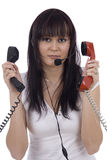 Busy telephonist. By three headphones on white background Royalty Free Stock Photography